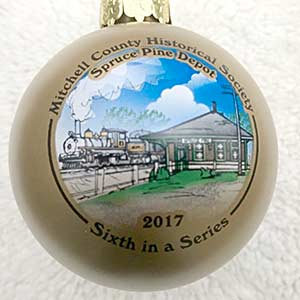 Photo of the Spruce Pine Christmas Depot ornament, which is gold in color