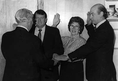 Danny Burleson, Doris Thompson, and Phillip Frye being sworn in as Aldermen of the Town of Spruce Pine by Robert Thompson in 1990.