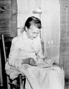Granny Biddix and her Bible.  Sometimes a picture is worth a thousand words. We don't know her first name, but her face tells the stories of a long life in the mountains of Mitchell County. Noted Mitchell County photographer Jim Jones took this picture, probably in the 1930's.  The information on the back simply reads: Granny Biddix and her Bible.