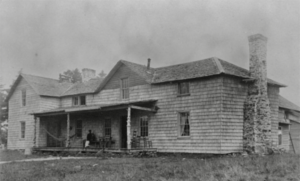 The original spruce-log, 20-room lodge built on Roan Mountain in 1877. Mr. L.B. Searle constructed this summer retreat for General Wilder prior to the impressive Cloudland Hotel.