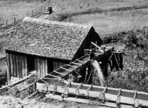 George Greenlee (1837-1913) built this mill (which was located near the present day Spruce Pine Chevrolet). Later his son Samuel ran the mill, grinding corn and flour. The water from Grassy Creek powered the mill.
