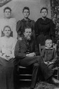 George Greenlee and his children. Front L to R – Etta, George, and Samuel. Back L to R – Ida, Ava, and Eva.