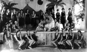 Camp As-You-Like-It's name comes from the famous Shakespeare play. Dramatics were also one of the activities, with the girls performing plays each season. This photo was taken in the 1920s before a performance in the playhouse.