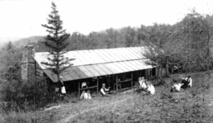 Pictured above is the main building of Camp As-You-Like-It in 1914. Marie Dwight added to a na- tive cabin to make the building when she opened in 1914. She operated it for 31 years, later selling to Jeanette Boone and Helen McMahon. They changed the name to Camp Glenlaurel and ran it until 1964. A series of owners then ran the camp until it closed in 1968.