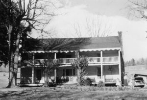 The Greenlee homestead built, by George and Jane McKinney Greenlee in the 1800's, was an iconic structure in the lush meadows of the Grassy Creek Community for decades. (It sat in the area between Grassy Creek Baptist Church and the Mitchell House). Samuel Davenport inherited the house from his father George. The house is gone from its original location. When it was razed, the home was rebuilt in another location. The only remnant that can still be seen today is the springhouse.