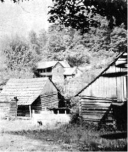 This view of the English Inn, taken around 1912, shows the corncrib and stable on the property. Mica processing was underway in a section of the Inn, and its days as a stop for travelers were nearing an end as the railroad arrived, drawing the new town across the nearby Toe River.