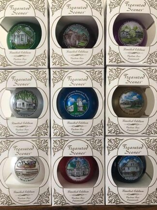 Photo of the nine available Christmas ornaments in their boxes