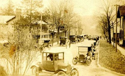 Photo of Main Street in Bakersville in the 1910s, featuring lots of automobiles