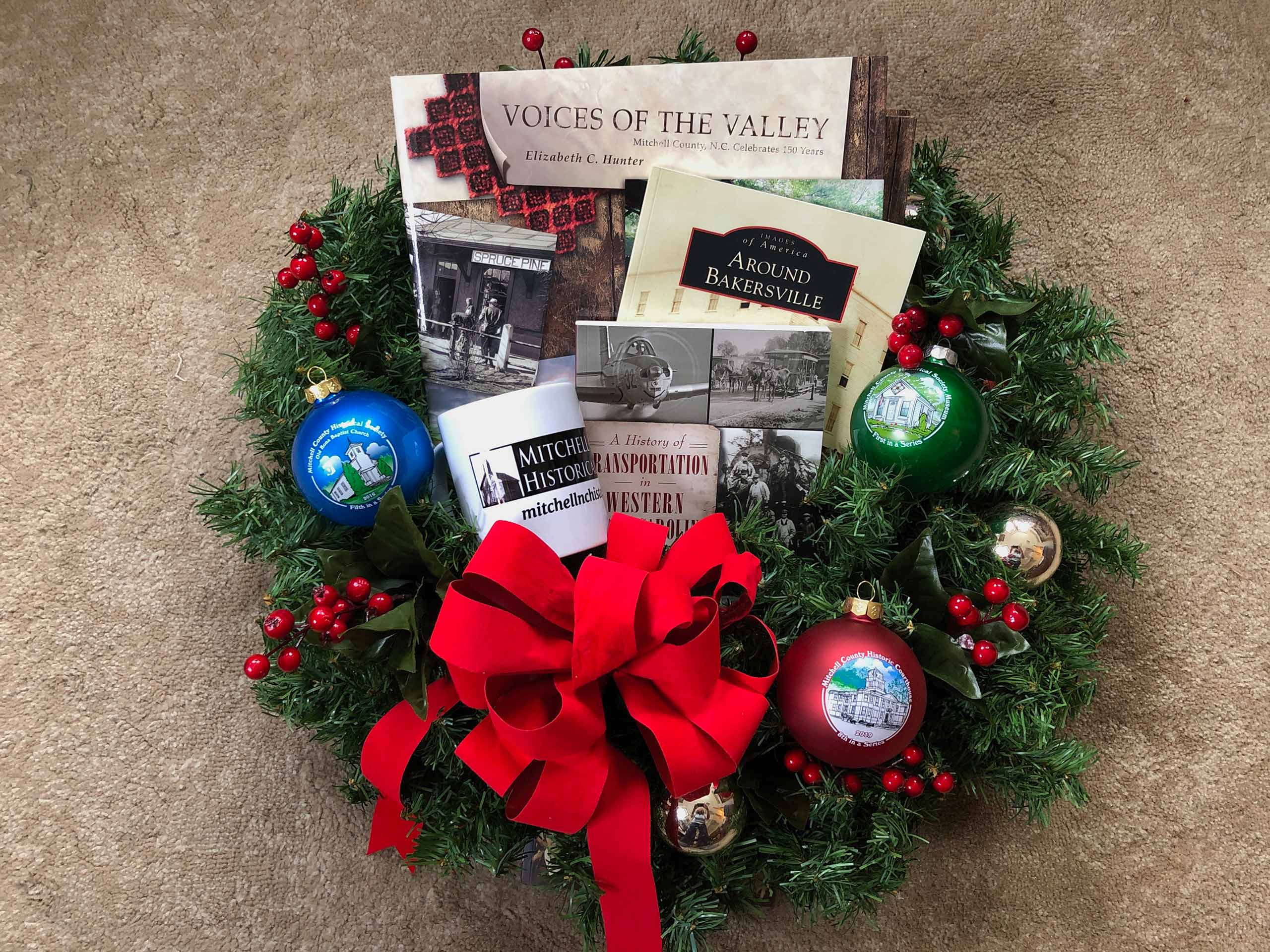 Photo of ornament and books in a Christmas Wreath