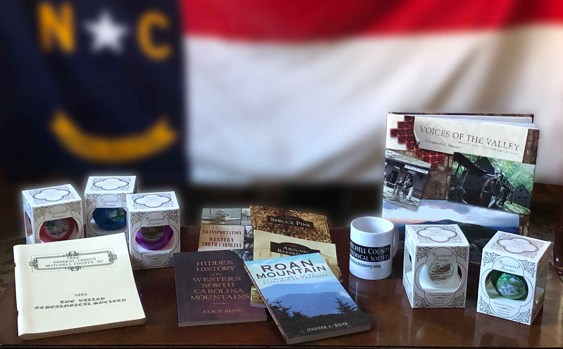 Photo of various books, Christmas ornaments and mugs offered for sale by the Mitchell County Historical Society