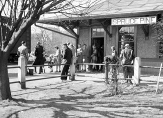 Photo of the Spruce Pine Depot with passengers waiting to board the train
