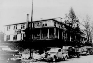 This view shows the original hotel built by Mr. Z. Taylor Phillips in 1901. (This scene portrays the building on the left side of Oak Avenue where the Toe River Arts Council is now located.