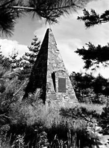 A picturesque monument was built for the plaque at Gillespie Gap.