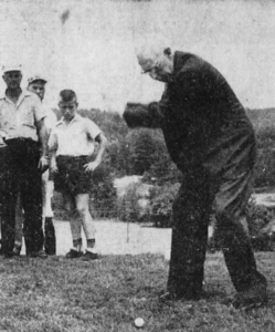 Prominent Spruce Pine physician, Dr. Charles Peterson, tees off at the official grand opening of the Spruce Pine Golf Course on August 15, 1956.