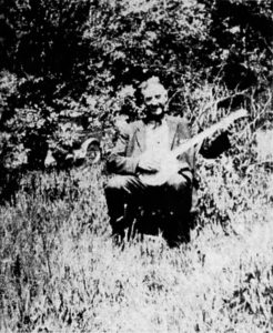 Picture of Doc Hoppes and his banjo.